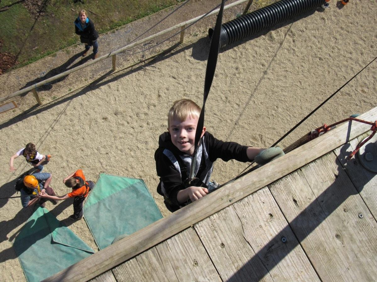 boy climbing wall small.jpg